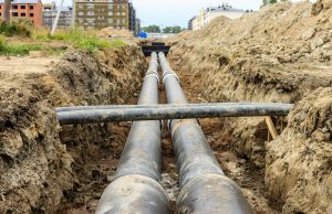 Long sewer pipes that have been dug up