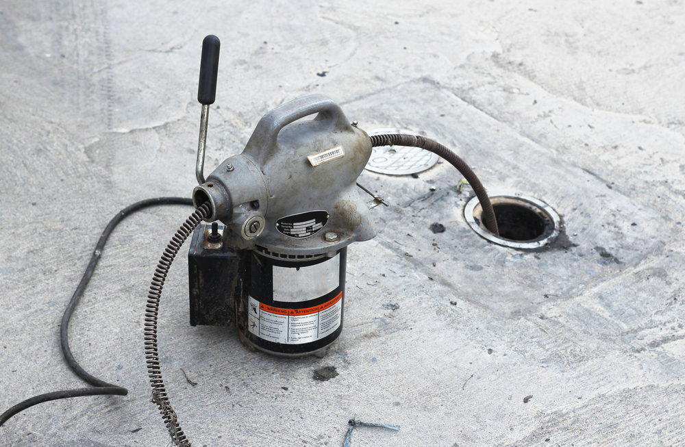 tool being used to clean sewer lines